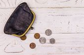 Old Change Purse With Several Coins On White Wooden Background. Concept Of Poverty Or Bankruptcy poster