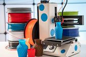 3D Printer Plastic filament for 3D printer and printed products in the interior of the design office poster