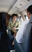 Businesswoman smiling on private airplane