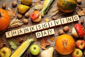 Cubes With Phrase Thanksgiving Day, Autumn Fruits And Vegetables On Wooden Table, Flat Lay. Happy Ho poster