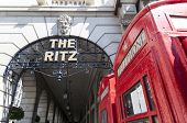 LONDON, UK - APRIL 30: Details of the Ritz hotel entrance, with red phone booth. April 30, 2012 in London. The luxury hotel dates back from 1905.