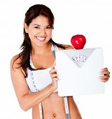 Healthy eating woman on a diet holding a scale - isolated over a white background