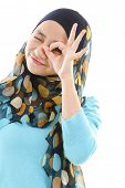 Young muslim woman focused by hand hole