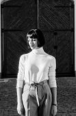 High Waisted Trousers Keep Returning To Catwalk. Woman Attractive Brunette Fashionable Outfit. High  poster