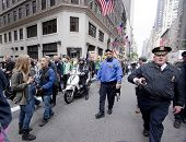 NEW YORK - MAY 1: Protesters march to Union Square from Bryant Park with a police escort during Occupy Wall St 'May Day' protests on May 1, 2012 in New York, NY.