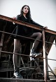 Fashion Shot: Portrait Of The Beautiful Rock Girl (informal Model) Dressed In Black Jacket And Skirt poster
