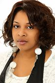 Beautiful Serious Black Woman Over White Background in Casual Clothing
