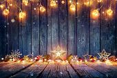 Christmas Decoration With Stars And String Lights On Rustic Wooden Table poster