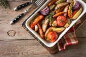 Oven Roasted Vegetables With Spices And Herbs In Baking Dish On Wooden Table. Vegetarian Vegan  Heal poster