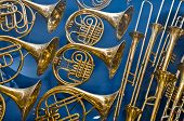 Background Of Repeating Brass Instruments. French Horns, Trumbets poster