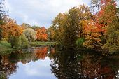October Autumn Park In Russia, Lake With Red Leaves And Reflection In The Lake, Alexander Park, Tsar poster