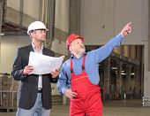 Engineer And Senior Worker In Warehouse