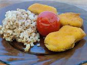 Buckwheat Porridge With Chicken Nuggets And Tomato