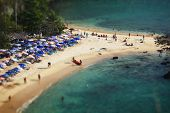 Tropical sandy beach and calm lagoon with clear blue water. Pseudo tilt shift. Ya Nui beach, Phuket,