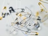 Floating Safety Pin On A White Background