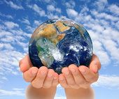 stock photo of take responsibility  - Hands of woman holding globe Africa and Near East - JPG