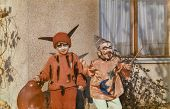 Vintage photo of children disguised in Carnival costumes, early eighties