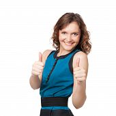 Portrait Of A Smiling Woman While Giving Two Thumbs Up