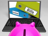 Bills And Invoices Files On Laptop Shows Finances