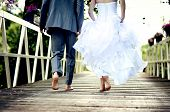 stock photo of bridges  - Beautiful wedding couple is enjoying their wedding - JPG