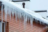 pic of icicle  - Winter hanging icicles on the house roof - JPG