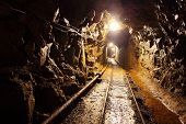 pic of cave  - Mine with railroad track  - JPG