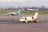 MOSCOW - SEP 22: Airliners stand on runway in Sheremetyevo airport on Sep 22, 2011 in Moscow, Russia