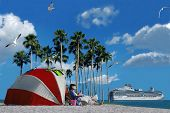 stock photo of cruise ship  - A cruise ship and a person relaxing on the beach  - JPG