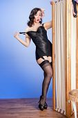 Teasing retro pinup in black corselet