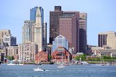 Boston downtown urban architecture with boat and city skyline.