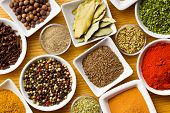 stock photo of cinnamon  - Various spices and herbs on wooden table - JPG
