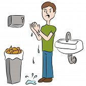An image of a man trying to dry his wet hands in a bathroom.