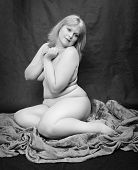 Black and white photography of a seductive overweight woman.