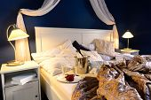 Rumpled sheets luxury hotel bedroom romantic night unmade bed