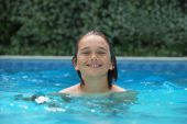 Smiling Teen In Swimming Pool