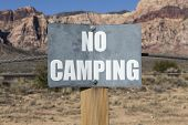 No camping sign on government owned parkland.