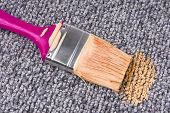 stock photo of unawares  - close up of the stained carpet with paint brush - JPG