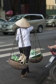 Vietnamese woman carries old paper and plastic