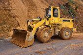 stock photo of landslide  - Bulldozer on a road in Laos - JPG