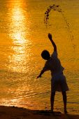 Throwing Sand At The Sunset
