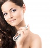 Beauty portrait of young, attractive, fresh, healthy and natural woman with the perfume bottle isola