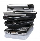 Pile of old mobile phones over a white background