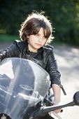 Kid sitting on road motorcycle