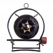 stock photo of vibration plate  - a small ancient gong isolated over a white background - JPG