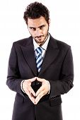 stock photo of cunning  - a young and handsome businessman in an evil pose isolated over a white background - JPG