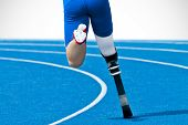 foto of paralympics  - Athlete with handicap on race track partly isolated - JPG