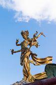 foto of bharata-natyam  - Six handed Bali goddes of dance statue against blue sky - JPG