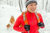 Woman Hiking In Winter With Dog