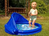 Surprised Toddler In Kiddie Pool