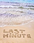 Last Minute Written On Sand, With Waves In Background